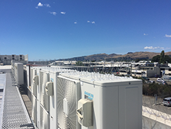 bird proofing applied to heat pumps on an industrial commercial building